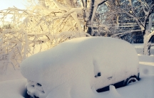 A car is covered in snow in Orchard Park outside of Buffalo, New York, November 19, 2014.