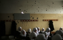 Palestinian school girls attend a class at their school that witnesses said was damaged by Israeli shelling during the most recent conflict between Israel and Hamas.