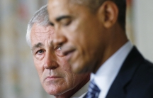Defense Secretary Chuck Hagel listens as President Barack Obama announces Hagel's resignation.