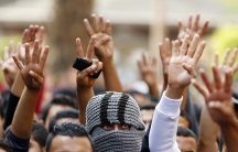 "Cairo University students shout slogans against the government and flash the ""V"" and ""Rabaa"" signs, protesting the release of former Egyptian President Hosni Mubarak's. Protests erupted at universities across Egypt on November 30, 2014, in response to the"