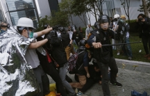 Hong Kong police baton-charged and pepper-sprayed thousands of pro-democracy demonstrators in the early hours of December 1, 2014. The protesters were trying to encircle government headquarters, defying orders to retreat after more than two months of prot