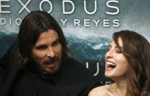 """Cast members Christian Bale and Maria Valverde pose for photographs as they arrive for the film world premiere of """"Exodus: Gods and Kings"""" in Madrid, Spain."""