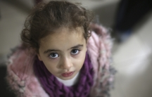 A Syrian child who lost both of her parents attends a gathering organized by a charity for orphans in Douma, near Damascus.
