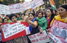 """Members of the All India Mahila Congress, the women's wing of the Congress {arty, carry placards that read, """"The country is covered in shame...""""  The women were protesting the rape of a female passenger by an Uber taxi driver in New Delhi."""