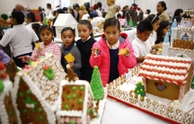 Local elementary school students vote for fairy tale and movie-themed gingerbread houses created by pastry students from the San Ysidro Adult School Culinary Arts program in San Ysidro, California on December 9, 2014.