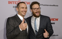 """James Franco and Seth Rogen pose during the premiere of the film """"The Interview"""" in Los Angeles on December 11, 2014."""