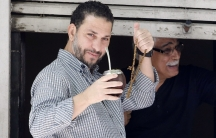 The recent releases from Guantanamo include former detainee Adel bin Muhammad El Ouerghi of Tunisia shown standing on a balcony in Montevideo, Uruguay, his new home.