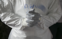 A doctor in protective clothing in the Ebola Training Academy in Freetown, Sierra Leone, on Dec. 16, 2014.