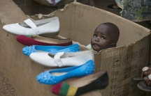 A baby looks out of a box at an outdoor market in Devils Hole, Sierra Leone. A new report suggests Ebola has created 12,000 orphans in the West African country.