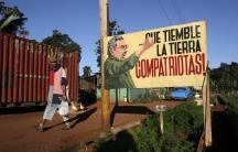A man walks near a sign with an image of Cuban President Raul Castro in Havana December 19, 2014.