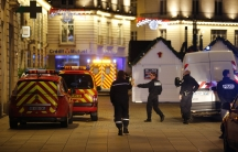 Police and rescue crews respond to the scene near where a man drove a van into a crowd, injuring 10 people, some seriously wounded, in Nantes, December 22, 2014.