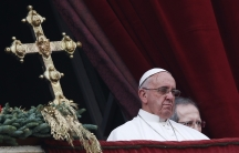 "Pope Francis delivers a ""Urbi et Orbi"" (to the city and world) message from the balcony overlooking St. Peter's Square at the Vatican on Christmas Day of 2014."