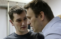 A Russian court ruled on Tuesday to give Kremlin critic Alexei Navalny (right) a suspended sentence for embezzling money, but jailed his brother Oleg (left) for three and a half years in a case seen as part of a campaign to stifle dissent.