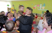 """North Korean leader Kim Jong-Un visits the """"Pyongyang Baby Home and Orphanage"""" on New Year's Day, in this photo released by the government-run Korean Central News Agency."""