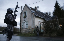 Members of the French GIPN intervention police forces secure a neighbourhood in Corcy, northeast of Paris.