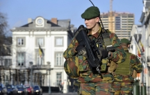 Belgian soldiers patrolling outside the US Embassy in Brussels, near the Belgian Parliament. Belgium has deployed hundreds of troops to guard potential targets of terrorism, including Jewish sites and diplomatic missions.
