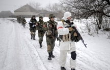 Ukrainian servicemen patrol a village in the Luhansk region of eastern Ukraine.