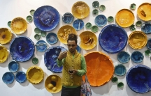 """A visitor takes a """"selfie"""" in front of art exhibit """"Circle Uncircled"""" by artist Rahul Kumar."""