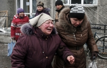 A woman cries as she waits for humanitarian aid in the battered town of Debaltseve in eastern Ukraine.