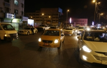 Vehicles are seen on a street in Baghdad as the Iraqi government lifted a night-time curfew.  Officials hope to demonstrate that Baghdad no longer faces a threat from Islamic State.