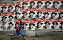 A schoolgirl walks past campaign posters in support of Nigeria's President Goodluck Jonathan along a road in Ikoyi district in Lagos.