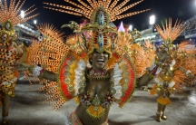 Revelers from the Beija Flor samba school participate in the annual Carnival parade in Rio de Janeiro's Sambadrome on February 17, 2015.