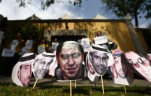 A picture of Saudi blogger Raif Badawi (C) is seen between others photos of prisoners in Saudi Arabia during a demonstration for his release from jail outside the Embassy of Saudi Arabia in Mexico City.
