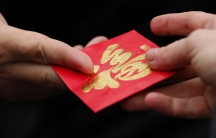 A red envelope is given out during Chinese Lunar New Year celebrations in Liverpool, England, on February 22, 2015.