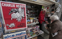 """The front page of satirical French weekly Charlie Hebdo, entitled """"C'est Reparti"""" (""""Here we go again"""") is displayed at a kiosk in Nice on February 25, 2015."""