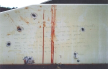 A blood-stained message prosecutors say Boston Marathon bomber Dzhokhar Tsarnaev wrote on the inside of a boat. The undated photo was presented as evidence to jurors at Tsarnaev's trial in Boston.