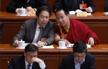 Gyaltsen Norbu (R), the 11th Panchen Lama, speaks with a delegate ahead of the opening of the third plenary meeting of Chinese People's Political Consultative Conference (CPPCC) at the Great Hall of the People in Beijing, March 11, 2015.