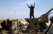 A fighter from Misrata shouts to his comrades as they move to fight Islamic State militants near Sirte.
