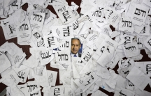 A photograph of Israeli Prime Minister Benjamin Netanyahu is seen on the floor with Likud party ballots at Likud party headquarters in Tel Aviv March 18, 2015.