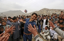 A man dances during celebrations for Afghan New Year, or Newroz, in Kabul on March 21, 2015.
