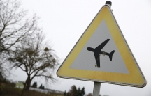 A traffic sign warning of low flying aircraft stands near to LSC Westerwald flight club, where Germanwings co-pilot Andreas Lubitz had been a member.