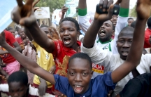 Supporters of Nigerian presidential candidate Muhammadu Buhari celebrate his election victory on March 31, 2015. Buhari is the first Nigerian to peacefully oust a sitting president under the country's democratic system.