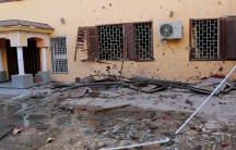 A view of damage after a bomb exploded at the gate of the Moroccan embassy in Tripoli on April 13, 2015.