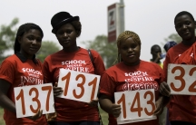 Students pose with placards as they join a march to mark the one-year anniversary of the mass kidnapping of more than 200 schoolgirls from a secondary school in Chibok by Boko Haram militants, in Abuja April 14, 2015.