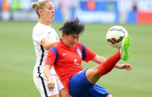 Korea defender Kim Sooyun (5) kicks the ball against USA forward Amy Rodriguez (8) during the second half at Red Bull Arena.