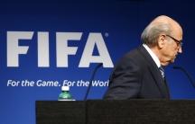 FIFA President Bladder leaves podium after resignation