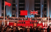 Hong Kong returned to Chinese sovereignty after 156 years of British colonial rule. The handover ceremony shows the Chinese flag flying after the Union flag was lowered on July 1, 1997.