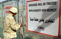 A US Army soldier from the 1st Infantry Division stationed in Tikrit closes the entrance of the dentention center at Forward Operating Base Danger on September 8, 2004.