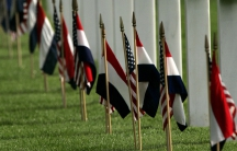 Dutch and U.S. flags decorate the graves at the American Cemetery and Memorial in Margraten.