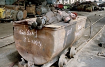 A Ukrainian miner sleeps on a coal trolley in the southeastern Ukrainian city of Donetsk in May 1998.