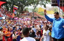 Venezuela's President Nicolas Maduro greets supporters during a meeting at Miraflores Palace in Caracas, Venezuela