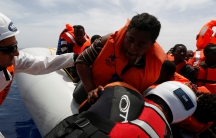 Migrant Offshore Aid Station rescues migrants from a rubber dinghy during an operation in the central Mediterranean
