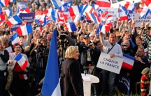 Le Pen attends a rally in Ennemain