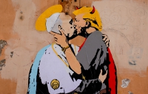 "A mural signed by ""TV Boy"" and depicting Pope Francis and U.S. President Donald Trump kissing, is seen on a wall in downtown Rome, Italy May 11, 2017."