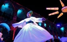 A Sufi dancer celebrating the holy month of Ramadan in Tripoli, Lebanon June 9, 2017.