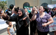 A group of women react as they talk about family members seized on Sunday by Immigration and Customs Enforcement agents during a rally outside the Mother of God Catholic Chaldean church in Southfield, Michigan, U.S., June 12, 2017.